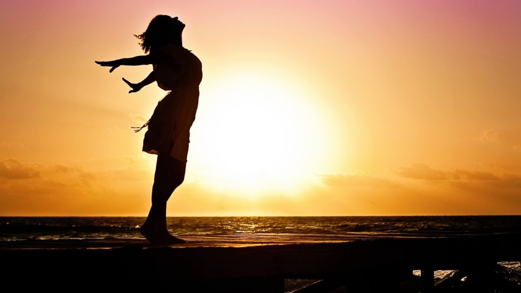 via https://pixabay.com/en/woman-happiness-sunrise-silhouette-570883/