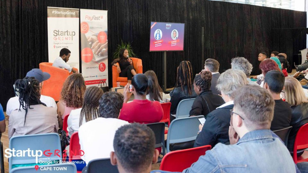 Featured image: Startup Grind Cape Town director Sandras Phiri (on stage, left) with Karisani IT Solutions CEO and co-founder Portia Masimula (on stage, right) at a Startup Grind Cape Town event at the Amazon Development Center in the city last month (Startup Grind Cape Town via Facebook)