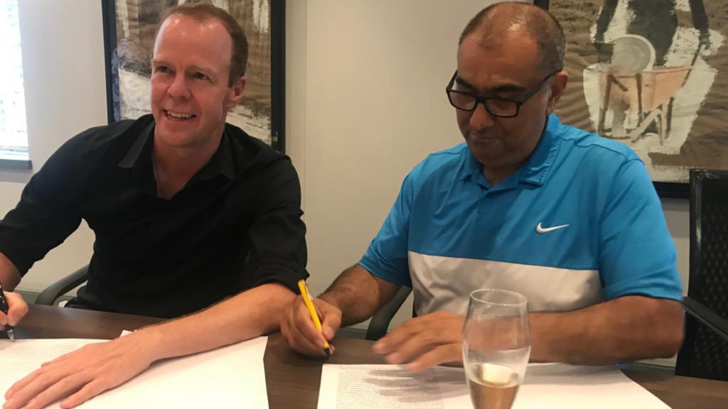 Featured image, left to right: Savant CEO Nick Allen and SA SME Fund CEO Ketso signing the deal yesterday ( Supplied, Savant)