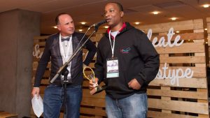 Featured image: MPost CEOAbdulaziz Mohamed speaking at the SA Innovation Summit in Cape Town after receiving first prize at the Main Pitching Den (SA Innovation Summitvia Twitter )