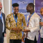 Featured image, left to right: ASME senior programme manager James Creel, Sesi Technologies' Peter O'Hara Adu and Isaac Senu Sesi receive an ASME ISHOW 3D-printed trophy from Villgro Kenya CEO and co-founder Robert Karanja (Supplied)