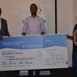 Featured image: Exuus founder and CEO (centre) receiving the prize at Seedstars Kigali (Dev't Bank of Rwanda, PLC via Twitter)