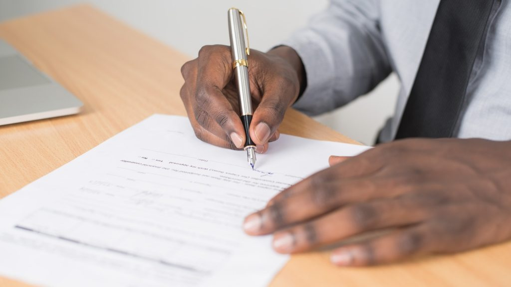 https://www.pexels.com/photo/person-holding-gray-twist-pen-and-white-printer-paper-on-brown-wooden-table-955389/