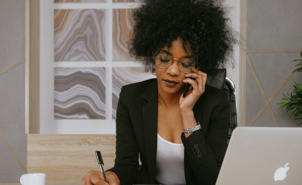 https://www.pexels.com/photo/woman-in-black-blazer-holding-smartphone-3727469/