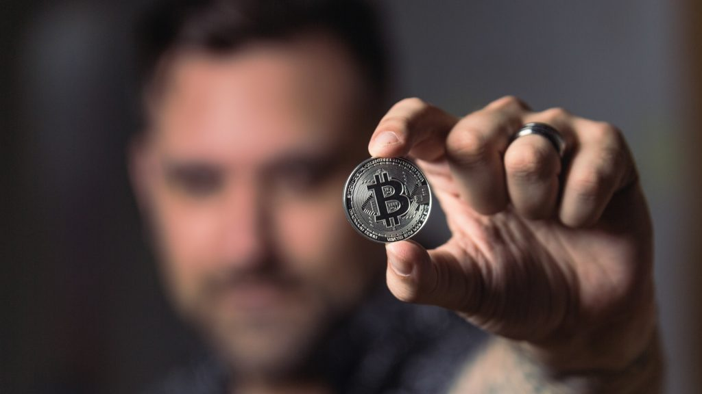 https://www.pexels.com/photo/person-holding-silver-bitcoin-coin-1447418/