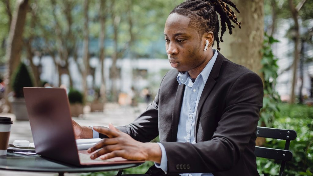 https://www.pexels.com/photo/focused-black-businessman-analyzing-data-on-laptop-in-street-cafe-4559598/