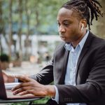 https://www.pexels.com/photo/focused-black-businessman-analyzing-data-on-laptop-in-street-cafe-4559598/