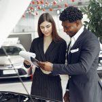 https://www.pexels.com/photo/happy-stylish-businessman-in-car-showroom-4173189/